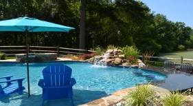 Pool with Tanning Ledge and Waterfall