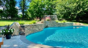 custom-pool-with-water-feature-and-landscaping