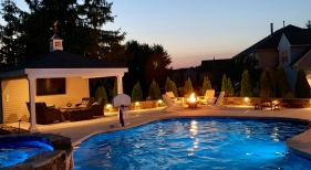 Freeform Pool with Fire Pit - Night View