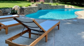 freeform-pool-with-raised-wall-and-sheer-descent