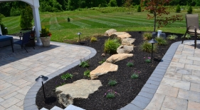 Techo Bloc Patio with Planting and Boulder Retaining Wall